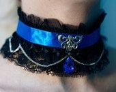 Art Nouveau inspired Gothic choker with a blue rhinestone