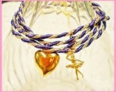 butterfly, heart, ballerina plus more mixed charmed purple and gold wrap around Bracelet
