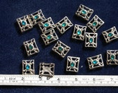 Vintage metal 2 hole sliders with green glass
