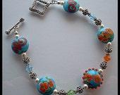 Handcrafted Sterling Silver Lampwork Swarovski Crystal and  Swarovski Pearl Bracelet
