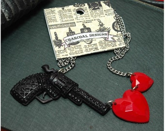 "Handmade  Hand Cast Resin - Love Is A Battlefield - Black Gun Shooting Hearts Necklace - 16.5"" Length"