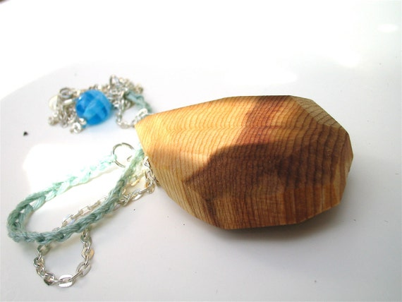 Boho Wood Necklace with handcarved cedar pendant and crochet chain. handmade by Even Howard. Pale mint green and neutral woodgrain.