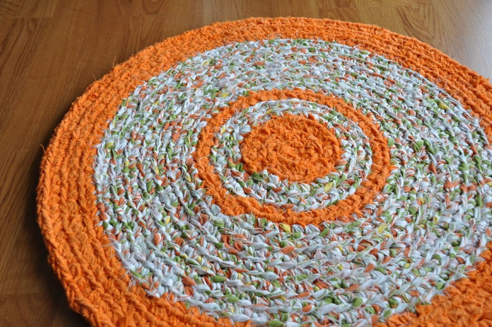 orange and avocado round crocheted upcycled area rug by ekra, blue and orange round rug, burnt orange round rug, large orange round rug