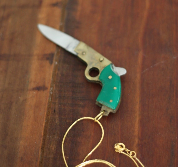 25% off sale plus Free Shipping with code BFCM12: Gun Pocket Knife Necklace with Emerald Green Bakelite Handle