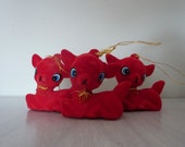 Vintage trio of red flocked deer ornaments