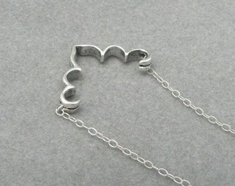 Flourish sterling silver necklace