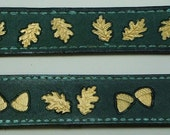 Hand painted leather wrist bands with gold oak leaf design