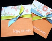 set of two orange and floral happy birthday mini greets