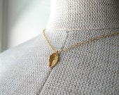 tiny gold leaf necklace - simple delicate jewelry by windowsill