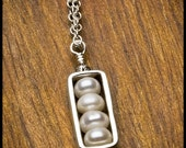 Anete's Response - Ivory Freshwater Pearl Rondelle Frame Pendant Necklace