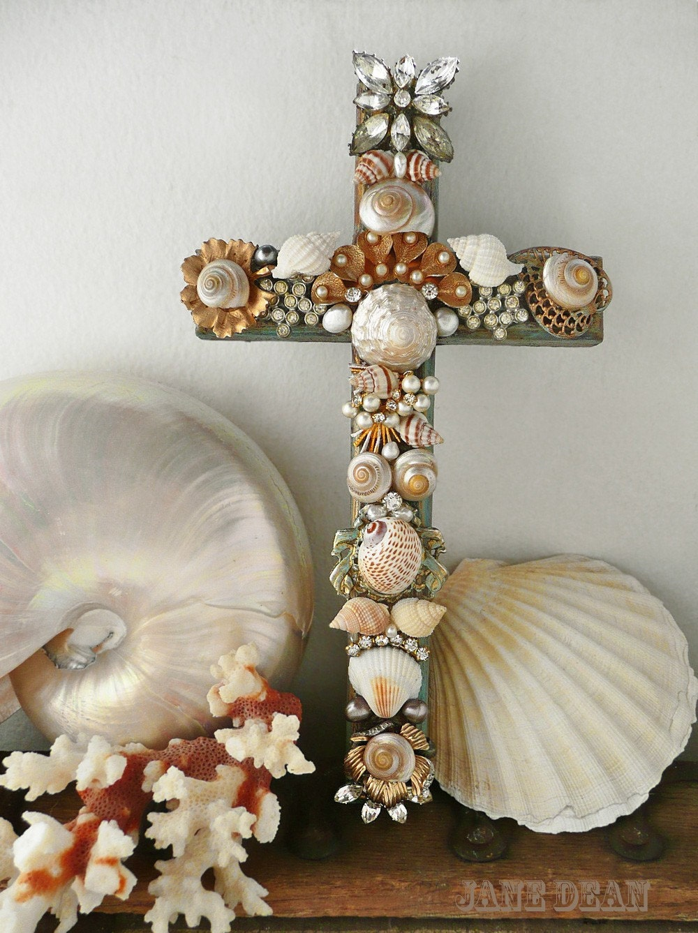 seashell and rhinestone cross embellished wall decor. Black Bedroom Furniture Sets. Home Design Ideas