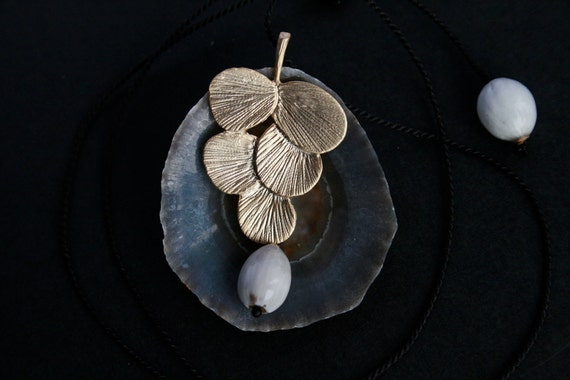 small brass necklace with natural seeds - organic jewelry - matte gold pendant