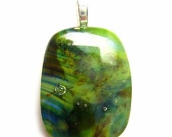 green kiln fused glass pendant--turbulence