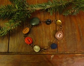Vintage multicolored button and copper bracelet