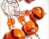 Swirly whirly (orange) - hand made stitch markers - set of 4