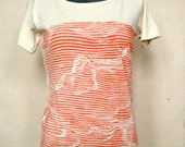 Women's boat neck wave tee in faded red