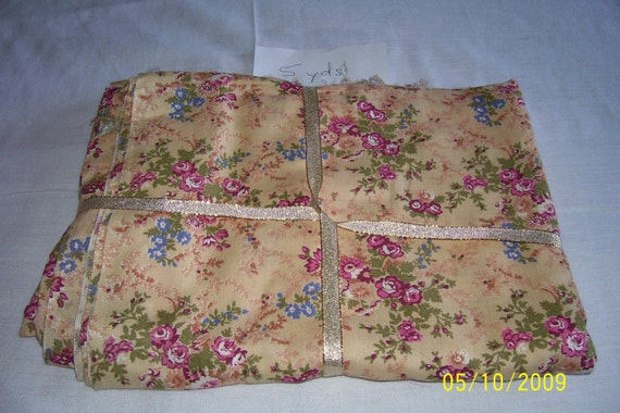 5 yards of floral fabric with small rose motif and light yellow background