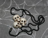 Boney skull pyramid, a necklace