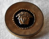 Buttons - 3 x gold and black coloured metal buttons with Greek goddess faces