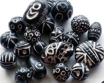 25 black and white clay beads from India