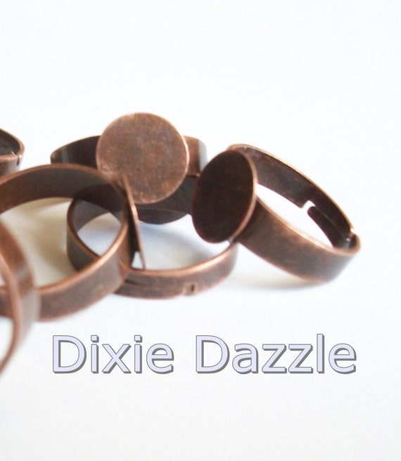 20 adjustable ring bases in antiqued copper with 10 mm glue pad