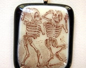 Scared Skeletons Day of the Dead fused glass pendant