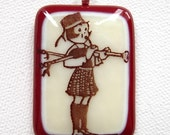 Retro Bagpiper Vanilla and Red fused glass pendant