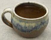 unique coffee mug green-brown glaze with brilliant accents