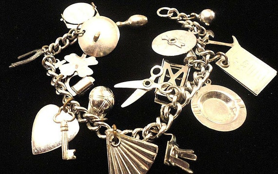 VINTAGE 50s Charm Bracelet Silver Tone with 16 Charms  that are: lucky, romance, kitchen, gardening, and Musical FREE Shipping