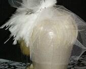 white feather veiled hair piece