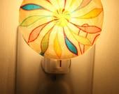 Nightlight rainbow pinwwheel design