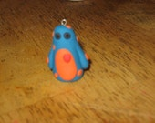 blue monster with orange polka dots charm