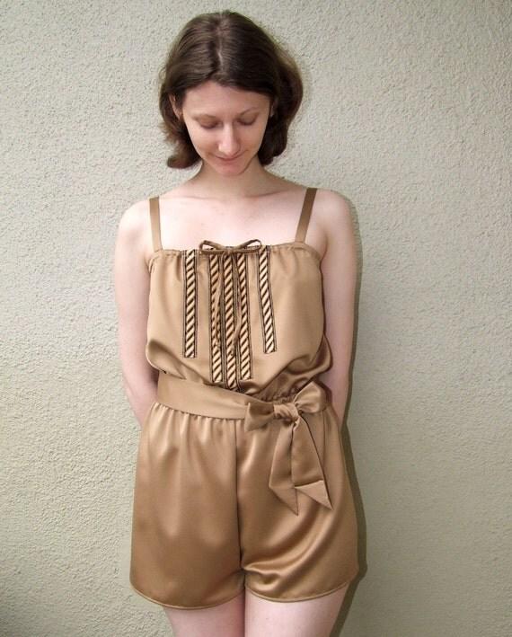 Gold satin romper pajamas with art deco trim