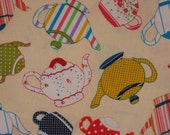 Cute Teapot FQ. Cotton fabric multicolored teapots on buttercream base fat quarter