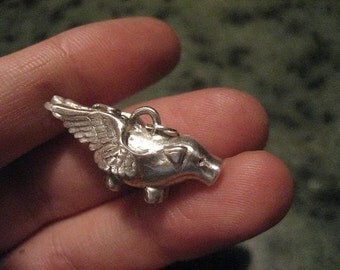 Fine silver flying pig pendant 3d
