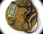 Toying with Time - Steampunk Monkey Brooch and Pendant with Pocket Watch Plate in Gold by Nouveau Motley