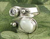 IVORY MOON SPIRAL adjustable sterling, mother of pearl and white cz ring