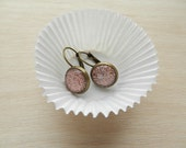 Pink glittered earrings