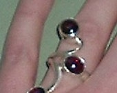UNUSUAL Sterling Silver and Garnet ring STUNNING