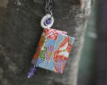 Wee Book Pendant (Japanese paper w/purple aventurine beads and white thread)
