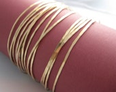 14 Thin Gold Hammered Bangles (for the price of 12)