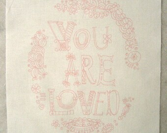 embroidery pattern on fabric You Are Loved, light pink