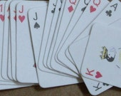 19 miniature paper playing cards
