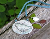 ceramic bird, mother of pearl leaf, peridot, and leather necklace