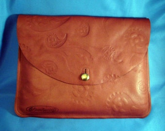 Steampunk leather iPad sleeve--hand embossed with original gear-paisley design