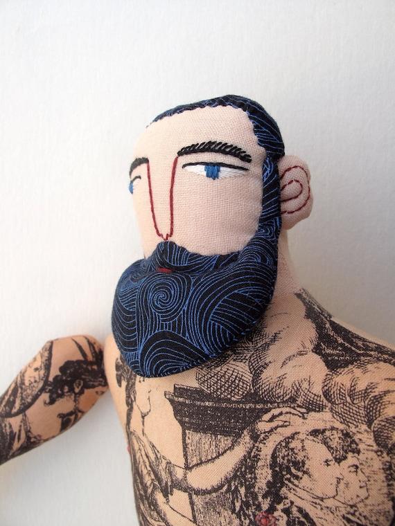 tattooed man with beard