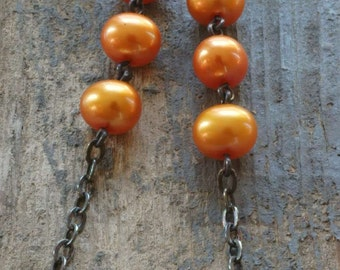 triple orange pearl earrings. freshwater pearls & oxidized sterling silver by val b.