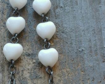 white hot hearts earrings. matte czech glass on oxidized sterling silver by val b.