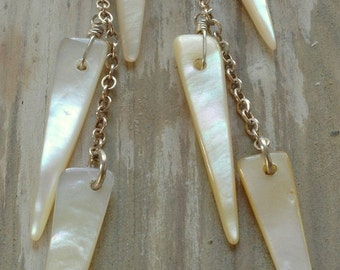 white spike shell earrings. creamy white shell wedges on sterling silver by val b.
