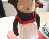 Fiona, a cheeky holiday monkey in a dress